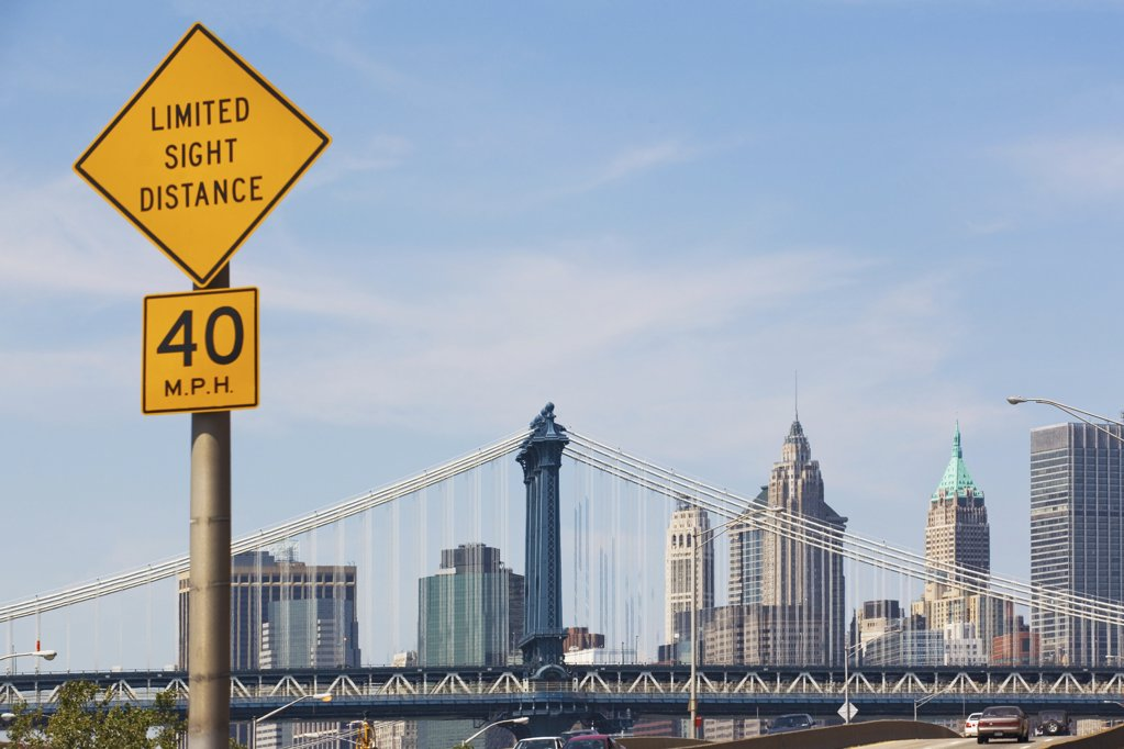 Stock Photo: 1439R-991335 Road sign and Manhattan skyline