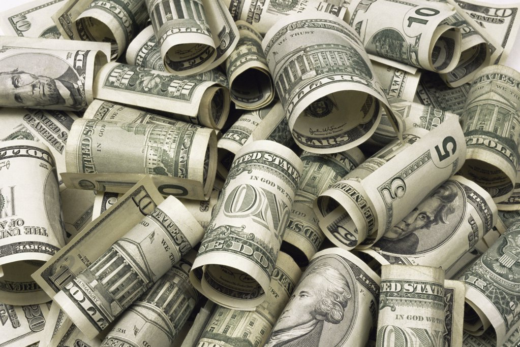 Stock Photo: 1439R-991519 Rolled up dollar bills
