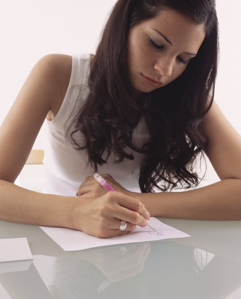 Woman drawing on some paper : Stock Photo