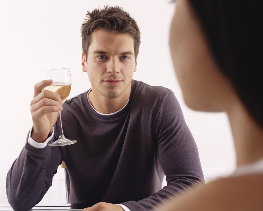 Stock Photo: 1439R-991754 Man having wine with woman