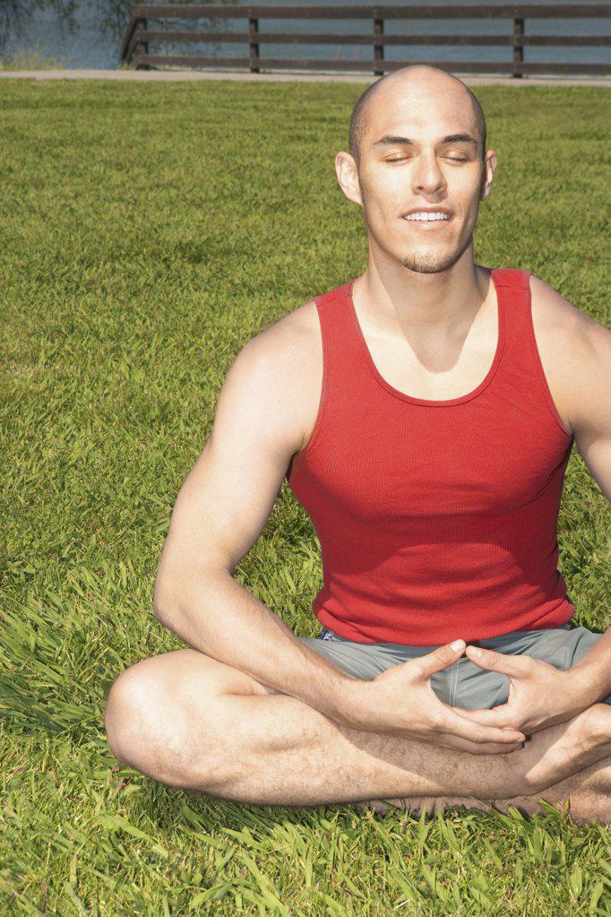 Man meditating : Stock Photo