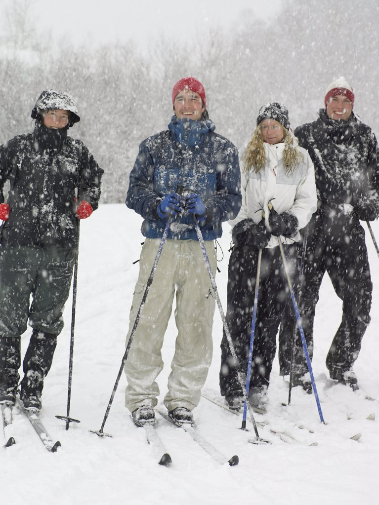 Stock Photo: 1439R-991872 Four friends on skis