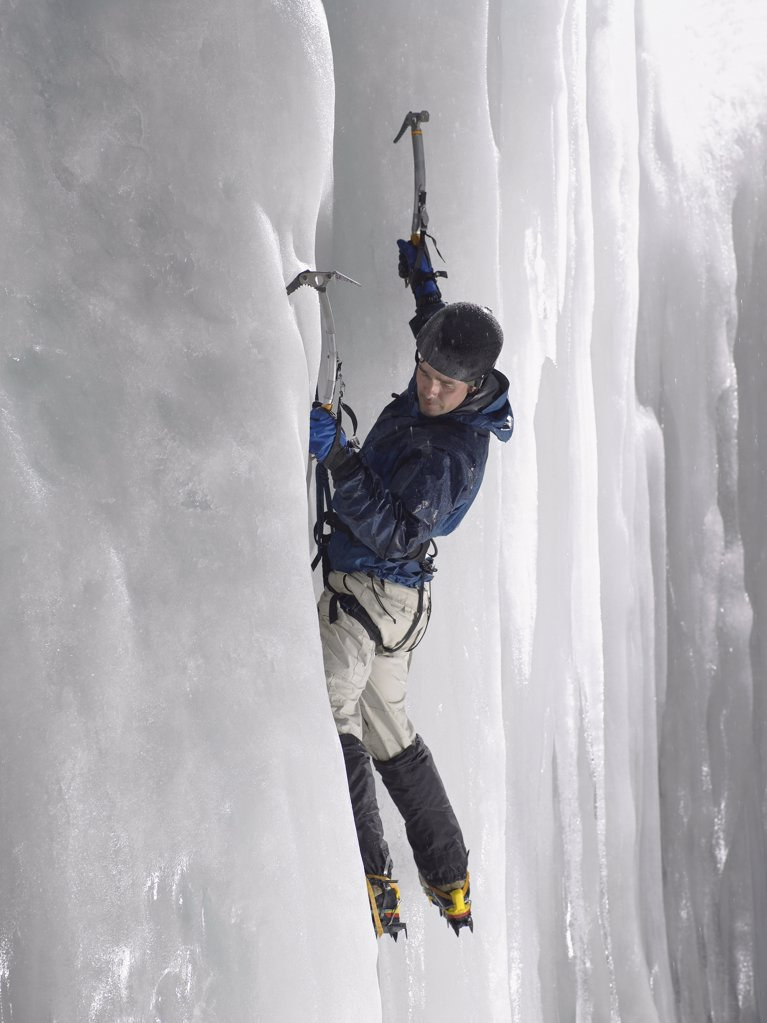 Man ice climbing : Stock Photo
