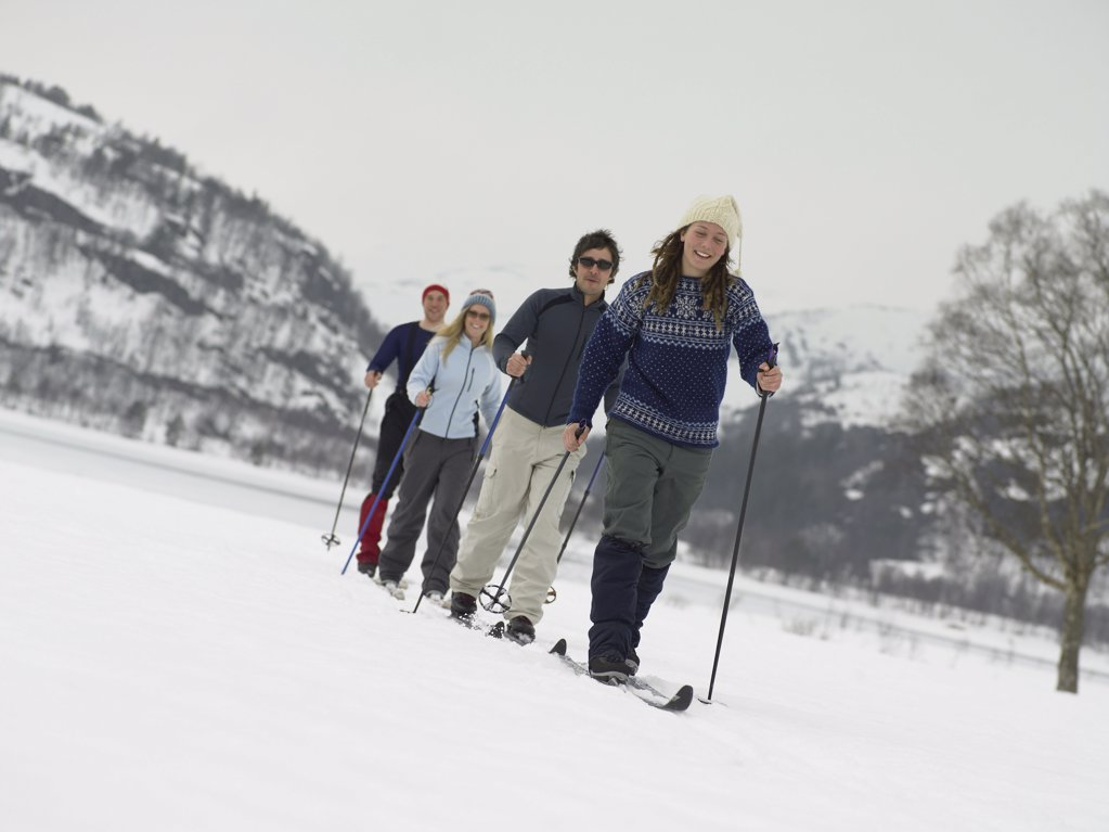 Stock Photo: 1439R-991923 Friends trekking through the snow