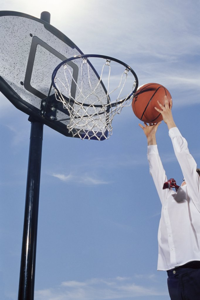 Stock Photo: 1439R-992054 Boy playing basketball
