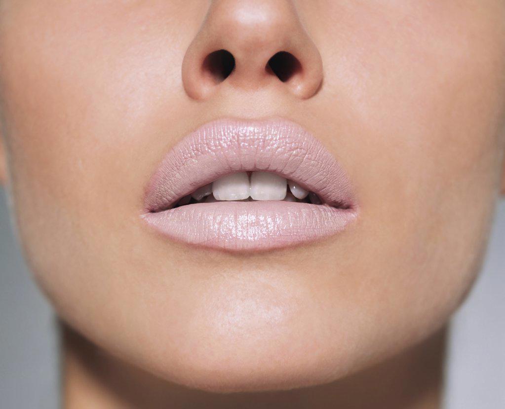 Woman wearing pale lipstick : Stock Photo