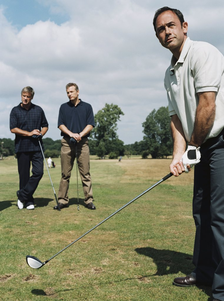 Stock Photo: 1439R-992411 Men playing golf