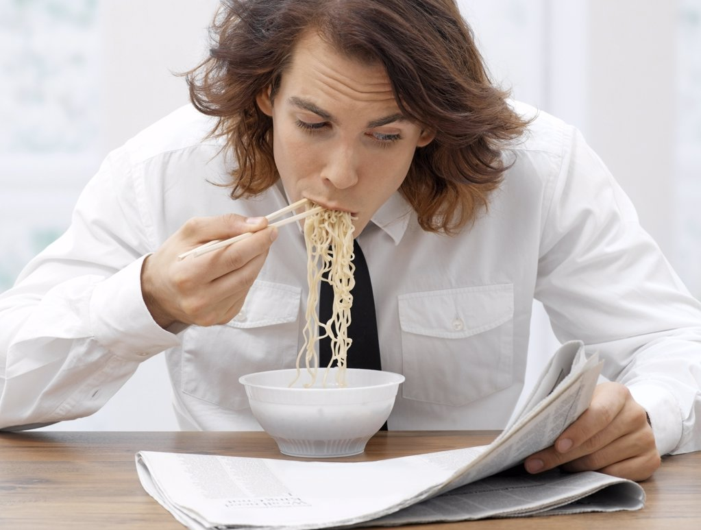 Stock Photo: 1439R-992501 Office worker eating spaghetti