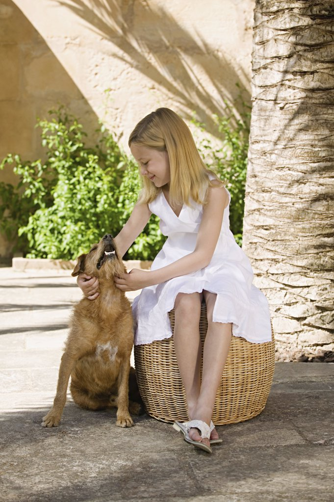 Stock Photo: 1439R-992650 Girl with pet dog