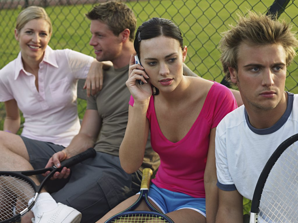 Stock Photo: 1439R-993247 Young people at tennis court