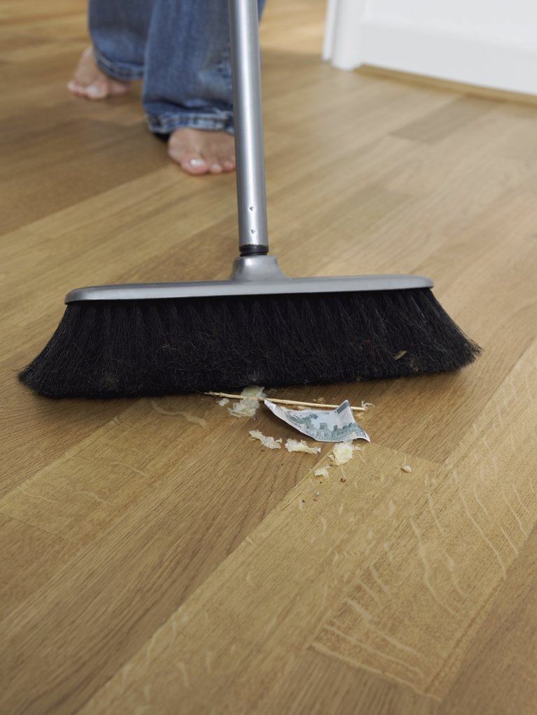 Woman sweeping up : Stock Photo