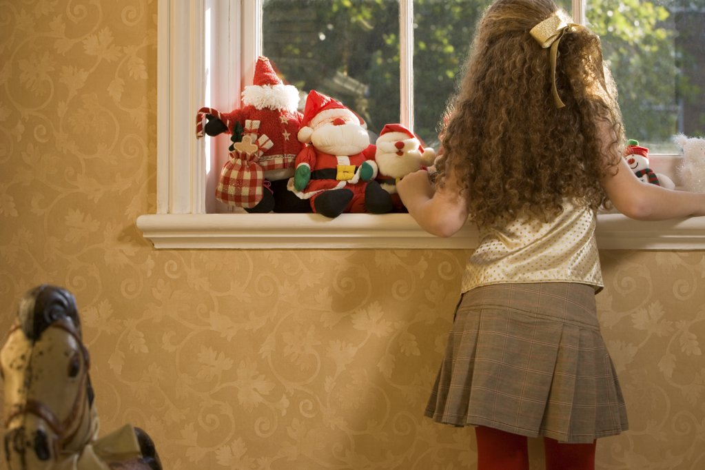 Stock Photo: 1439R-993978 Girl waiting for santa claus