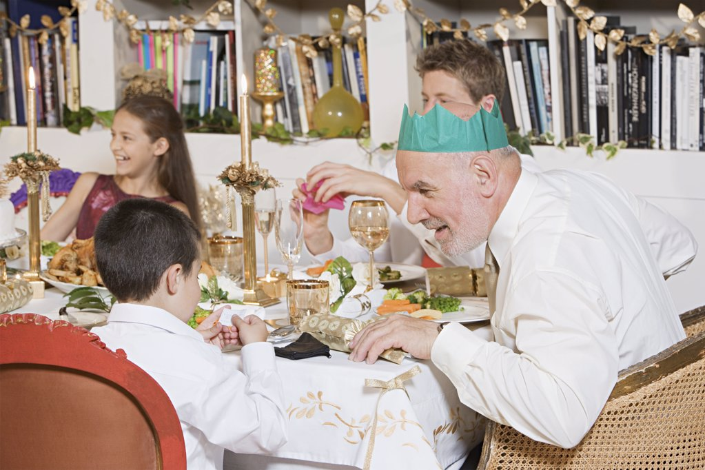 Family at dining table at christmas : Stock Photo
