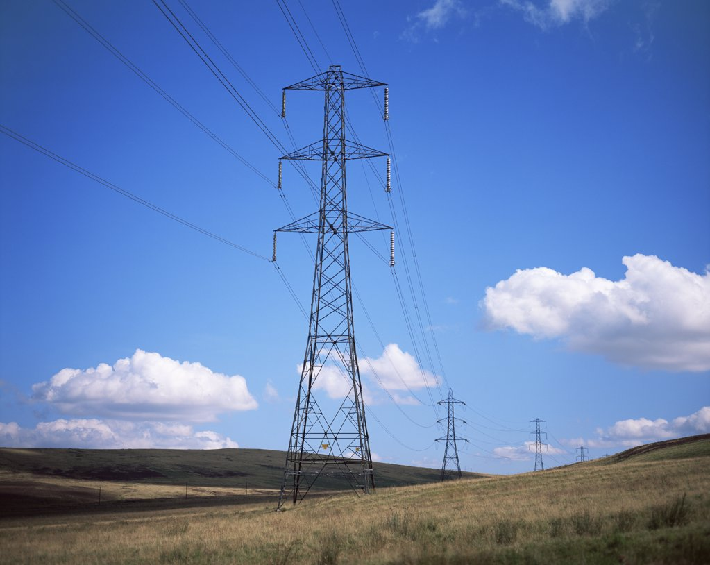 Electrical towers in field : Stock Photo