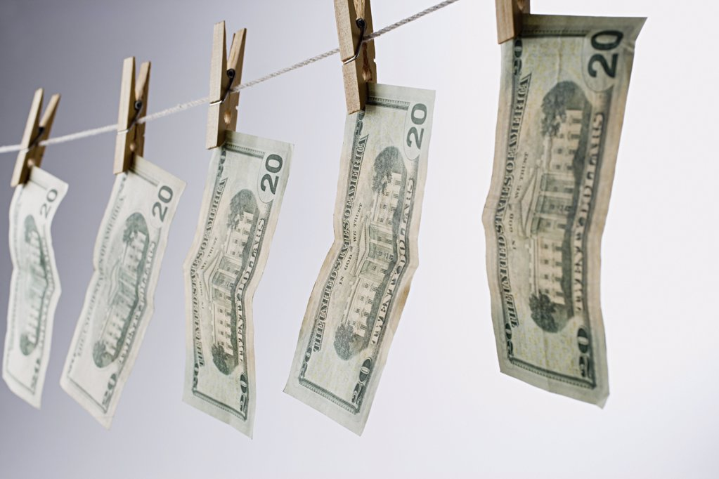 Banknotes on a clothesline : Stock Photo