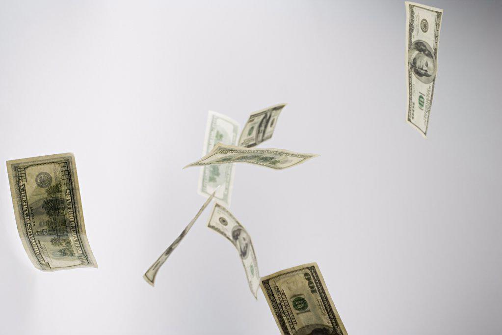 Falling hundred dollar bills : Stock Photo