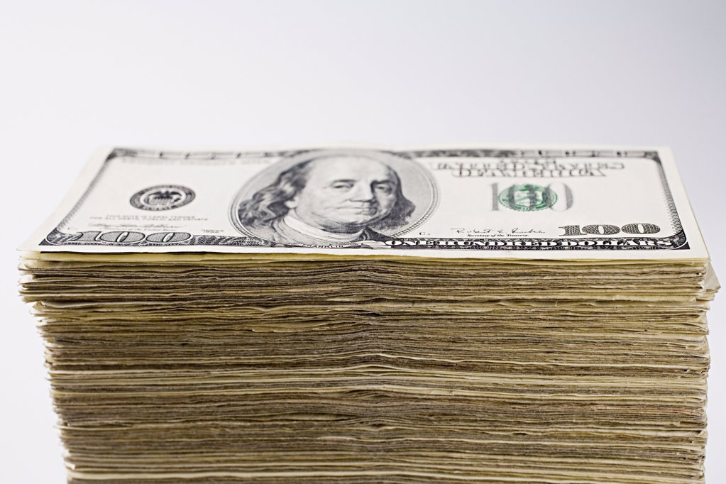 Stock Photo: 1439R-997704 Stacks of dollars