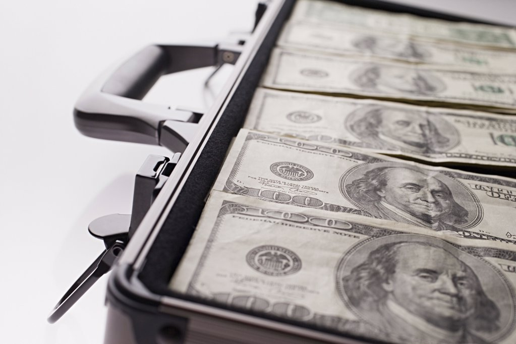 Briefcase full of money : Stock Photo