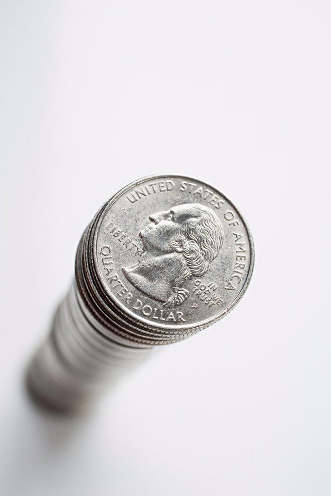 Stock Photo: 1439R-997755 Stack of quarter dollars