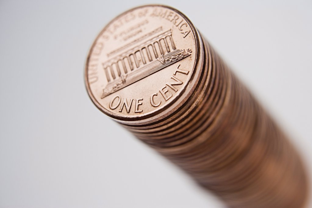 Stack of one cent coins : Stock Photo