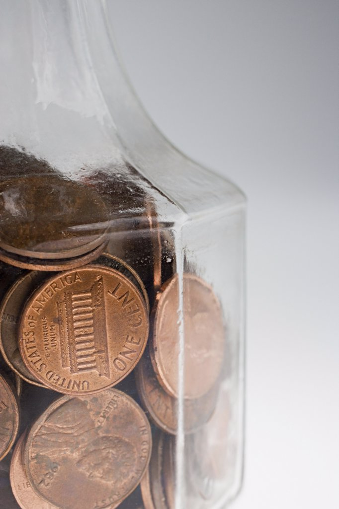 Decanter of one cent coins : Stock Photo