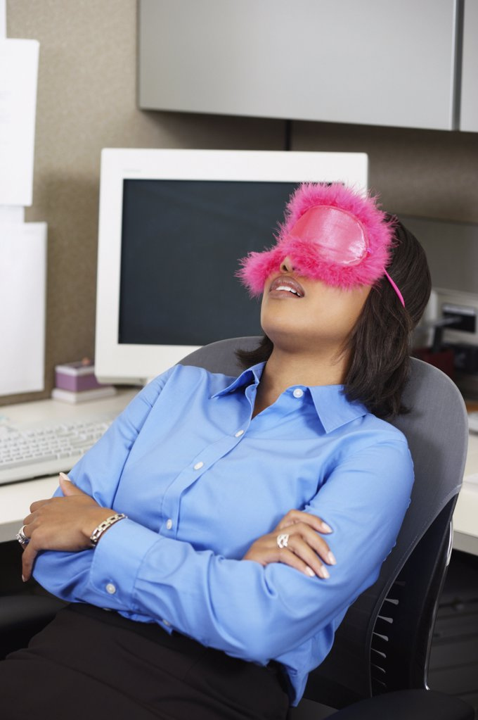 Business woman sleeping at her desk : Stock Photo