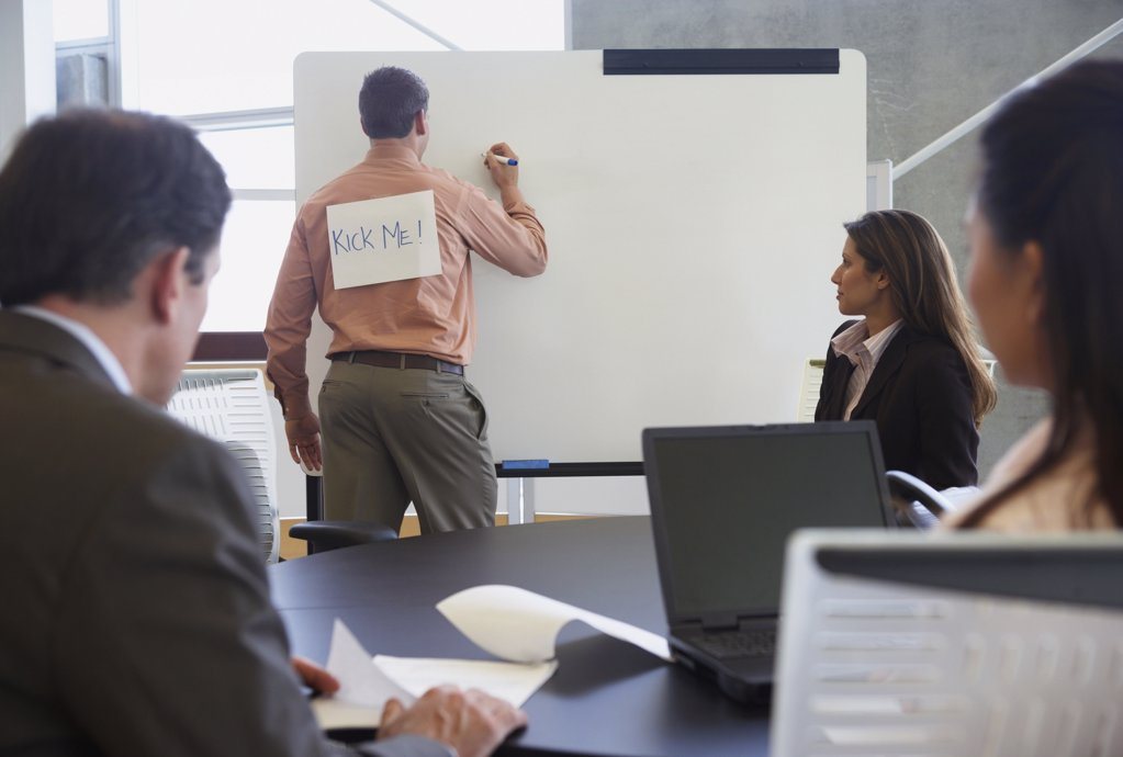 Businessman with sign on his back : Stock Photo