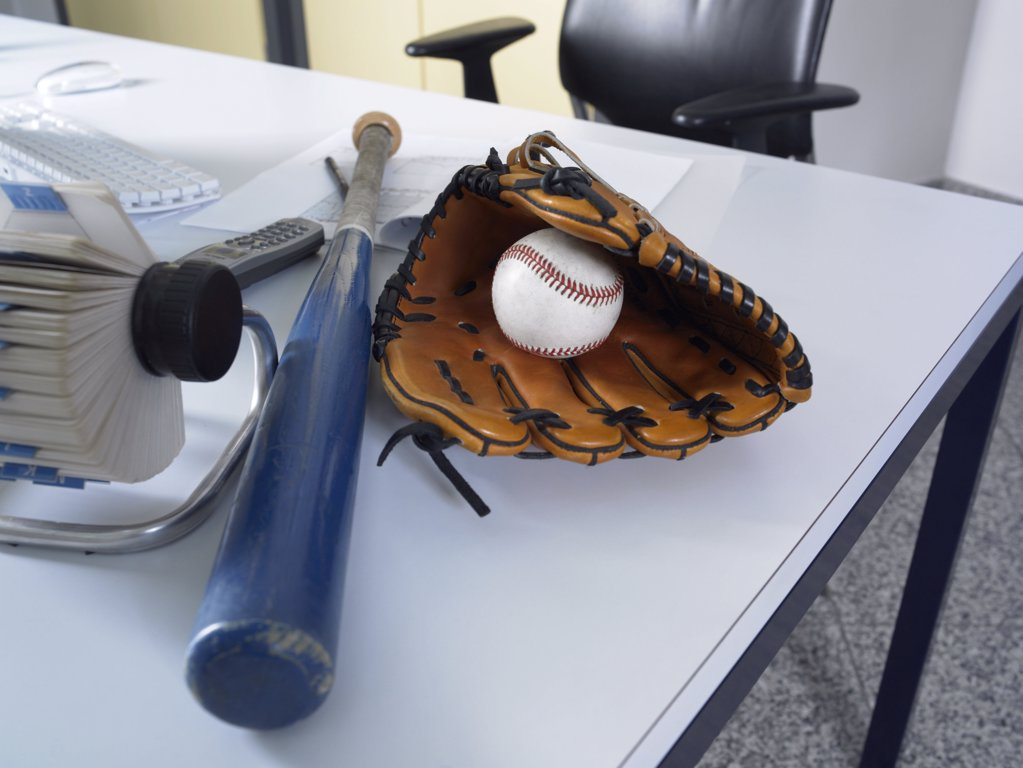 Stock Photo: 1439R-998350 Baseball equipment on a desk