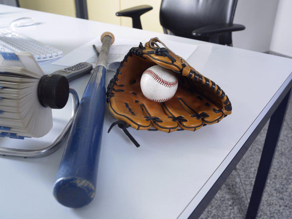 Baseball equipment on a desk : Stock Photo