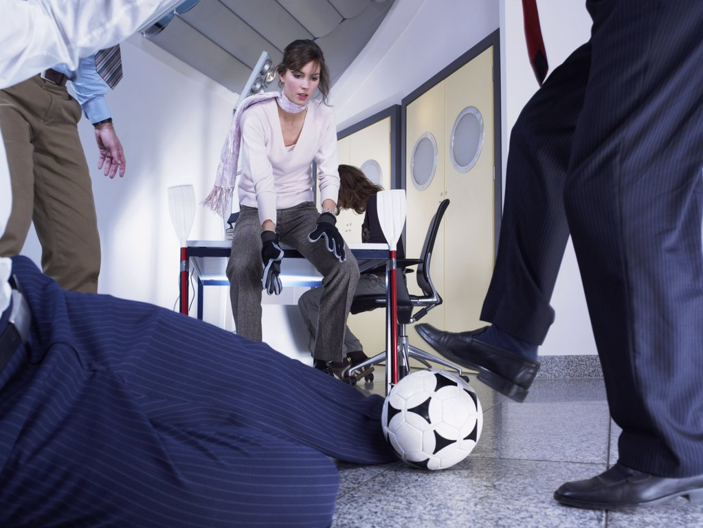 Office workers playing football : Stock Photo