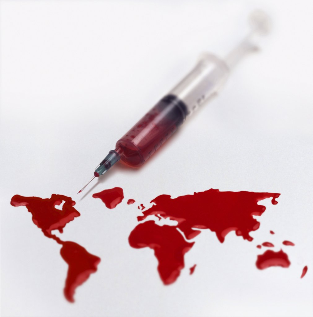 Stock Photo: 1439R-998829 Syringe and a world of blood