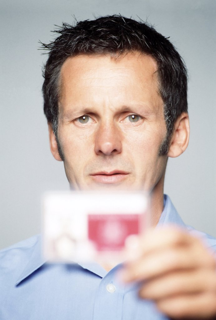 Man holding an identity card : Stock Photo