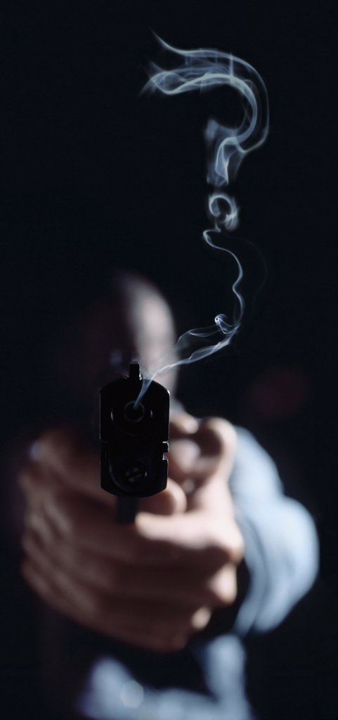 Question mark in gun smoke : Stock Photo