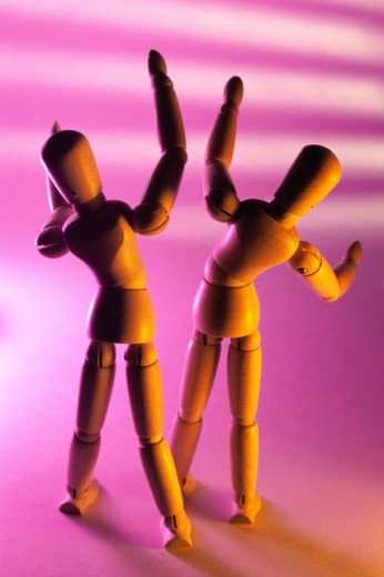 Close-up of two wooden dolls : Stock Photo