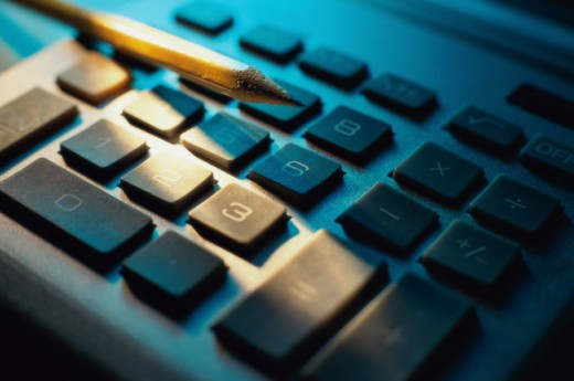 Stock Photo: 1441R-789 Close-up of a pencil on a calculator