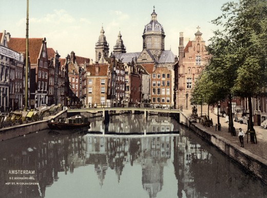 Reflection of buildings in water, Oudezijds Voorburgwal, Amsterdam, Netherlands : Stock Photo