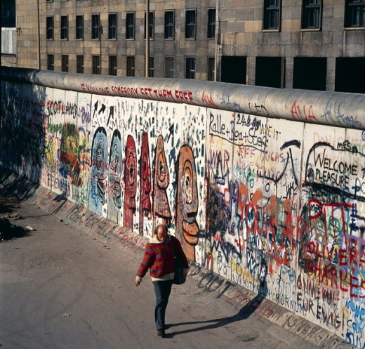 Stock Photo: 1443-955 High angle view of a man walking near a surrounding wall, Berlin Wall, Berlin, Germany, c. 1981