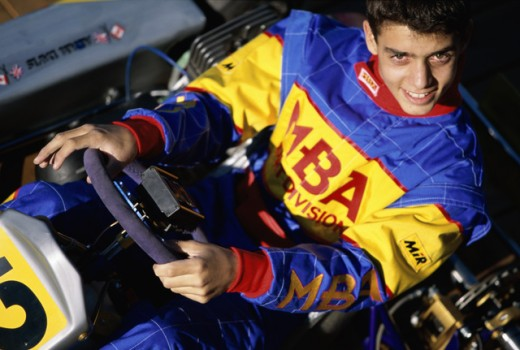 Stock Photo: 1445-628 High angle view of a young man sitting in a racecar