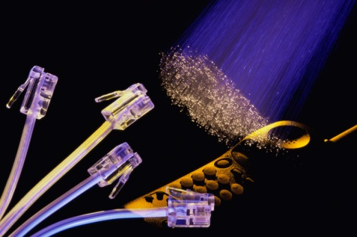 Telephone cables with jacks, fiber optics and a cordless phone : Stock Photo