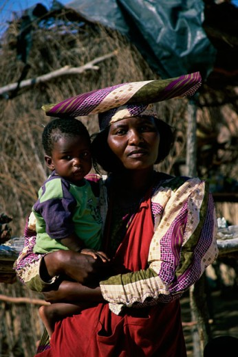 Stock Photo: 1447-W312 Portrait of a mother carrying her son, Namibia