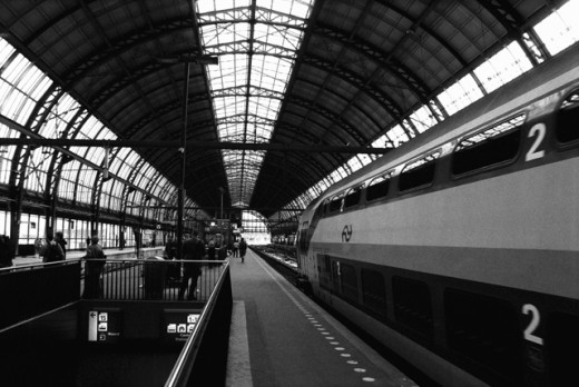 Passenger train at a railroad station, Amsterdam, Netherlands : Stock Photo