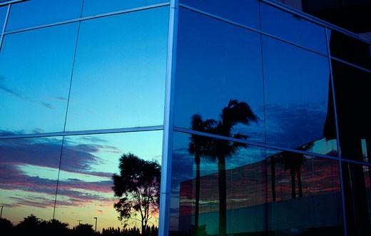 Reflection of sunset on glass window, Santa Clara, California, USA : Stock Photo