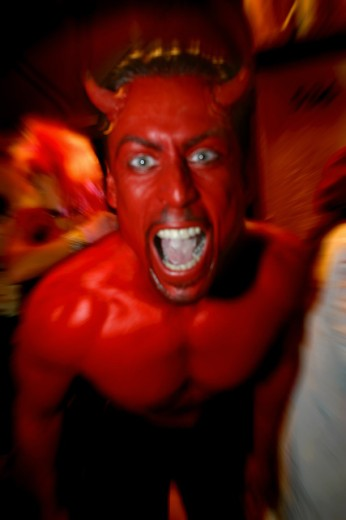 Stock Photo: 1467-1247 Portrait of a young man wearing devil horns