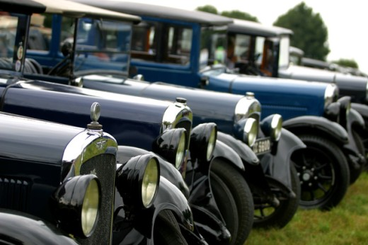 An array of vintage cars in a field : Stock Photo