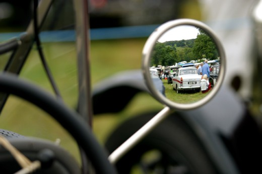 Stock Photo: 1467-2146 Reflection of people and cars in a side view mirror of a car