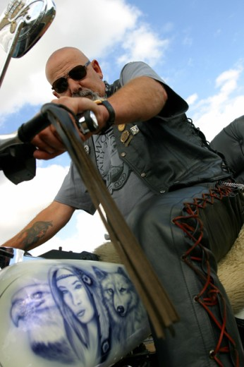 Low angle view of a mature man riding a motorcycle : Stock Photo