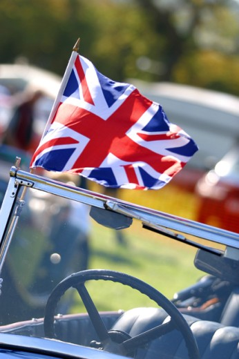 High angle view of a British flag on a convertible car : Stock Photo