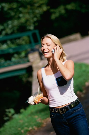 Stock Photo: 1467-773 Young woman talking on a mobile phone