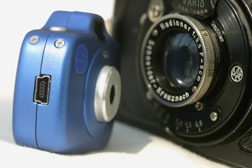 Close-up of an analogue camera and a digital camera : Stock Photo