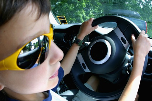 Close-up of a boy sitting in a car : Stock Photo